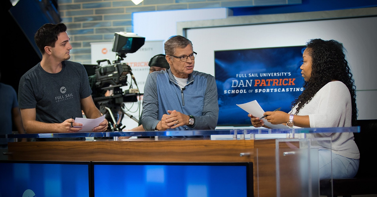picture shows dan patrick working with full sail students
